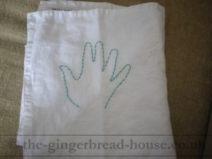 embroidered handprint