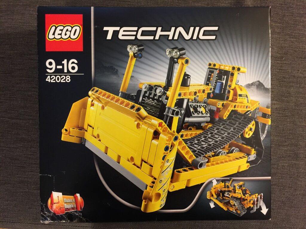 Box of Lego Technic bulldozer set