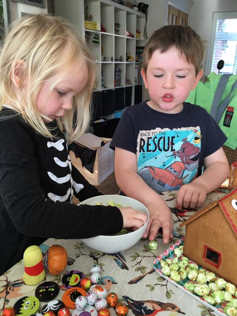 decorating a Halloween gingerbread house