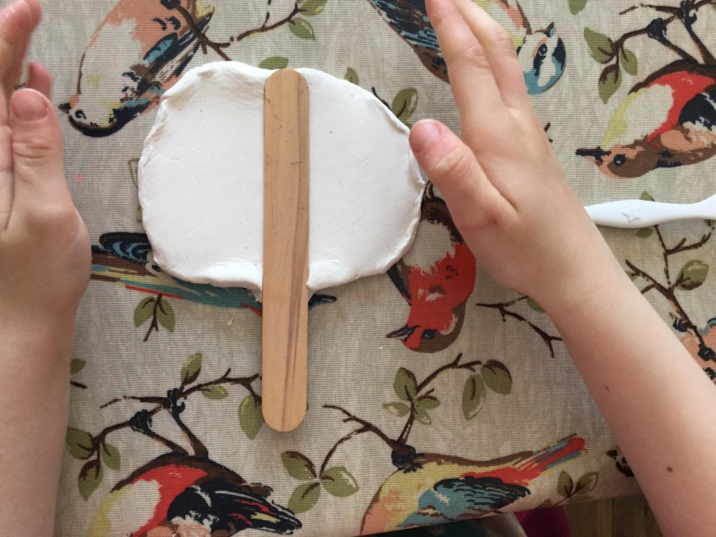 child playing with air drying clay