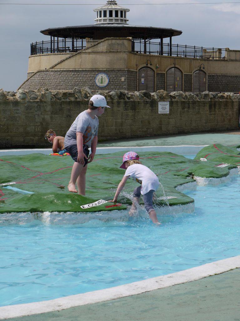 two children paddling