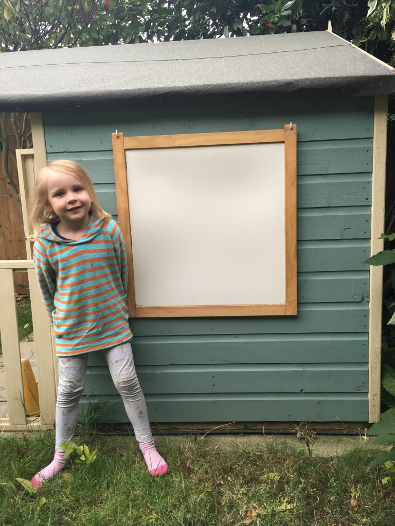 Customising our children's playhouse with a blackboard